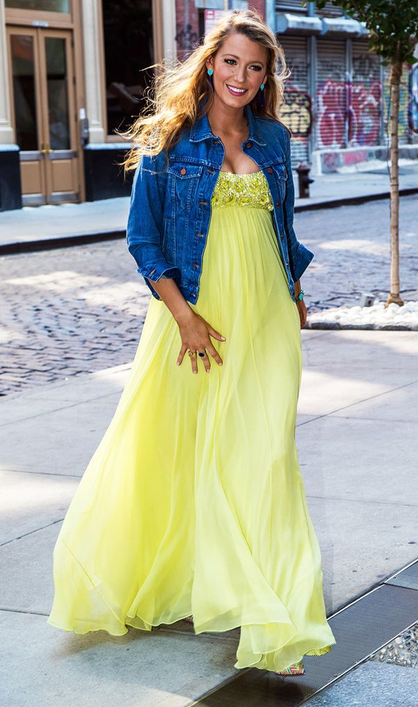 Blake Lively wearing yellow dress and jean jacket.