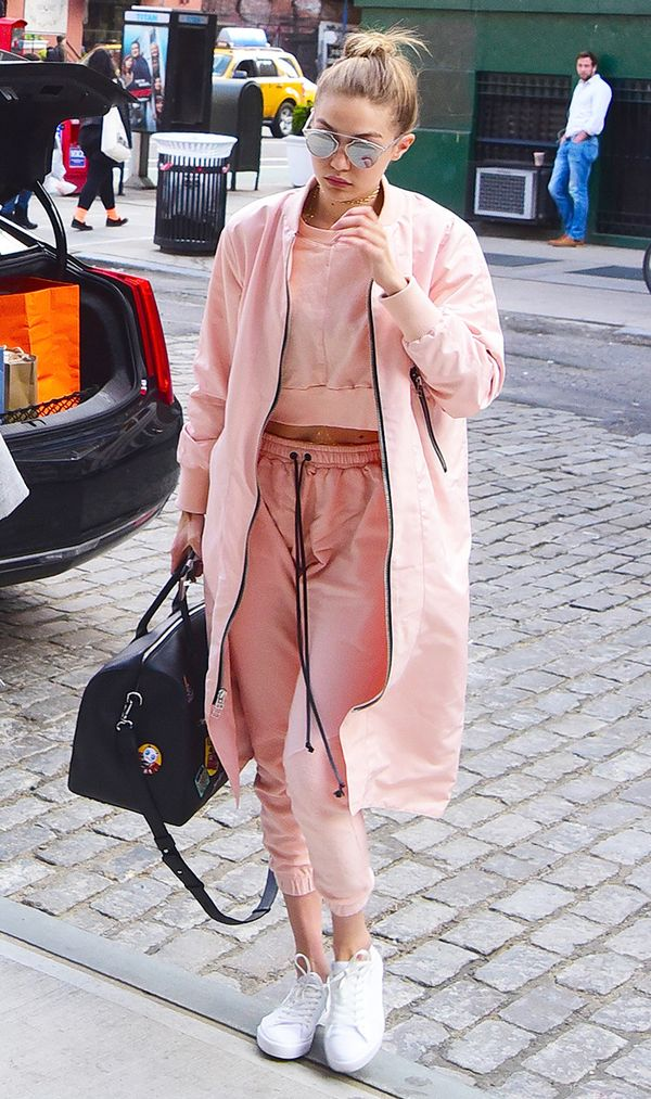 Gigi Hadid wearing pink tracksuit.