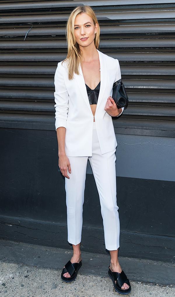 Karlie Kloss wearing white suit