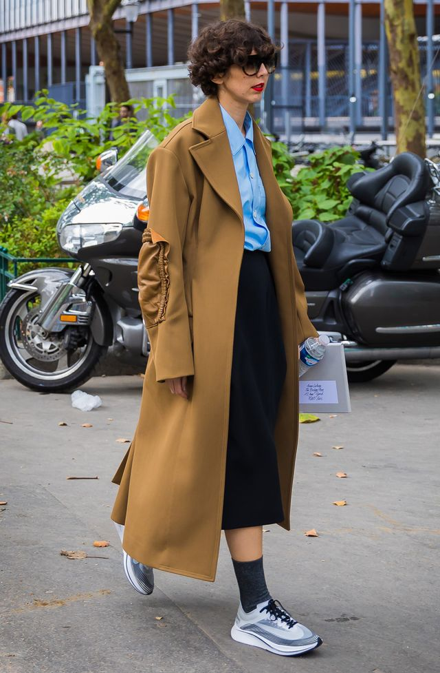 Keep your socks tall when wearing a shortened hemline skirt. And remember: Everything looks polished with a classic (but with a twist) camel coat.