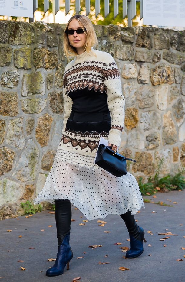 Wear a longer sweater over a skirt and knee-high boots to avoid exposing skin to cold temps.