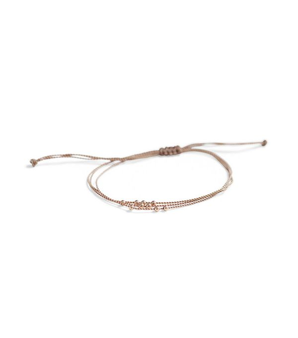 how to layer jewelry - Hortense Friendship Bracelet With Rose Gold Beads