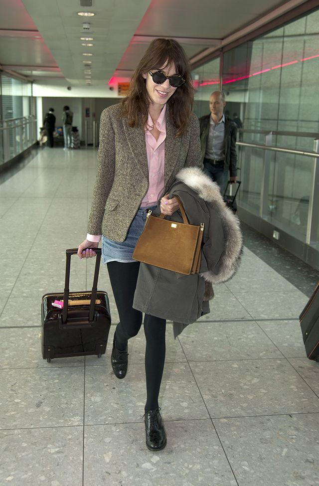 On Alexa: Tweed blazer; pink button-down shirt; faded denim shorts; black tights; lace-up oxfords.