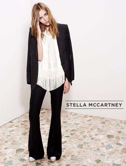 Black Dry Suiting Finch Jacket ($615) Calico Silk Chiffon Crepon Columbia Top ($895) Black Viscose Suiting Carlton Trouser ($745)White Nathalie Canvas Wedges ($760) Available now at Stella...