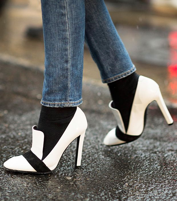 Style note: Hit on the bold black and white trend with a pair of sleek heeled loafers.