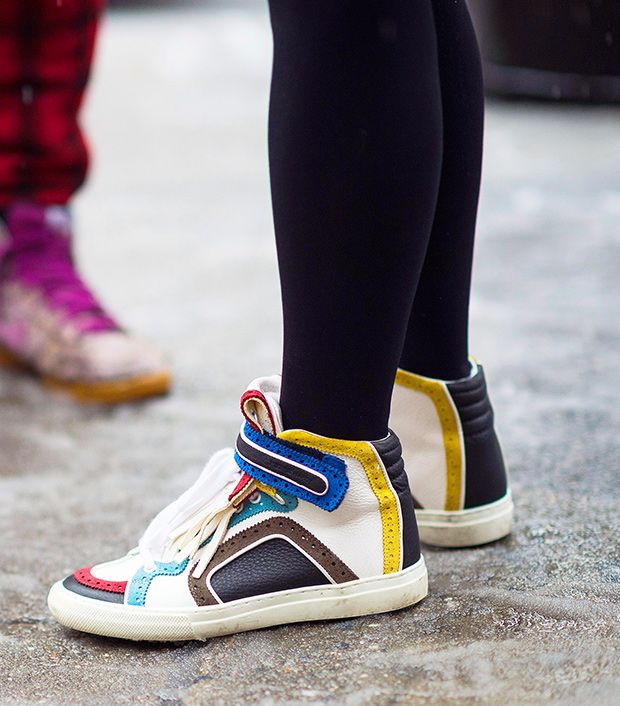 Style note: Bright high-top sneakers are a stylish throwback to the '80s.