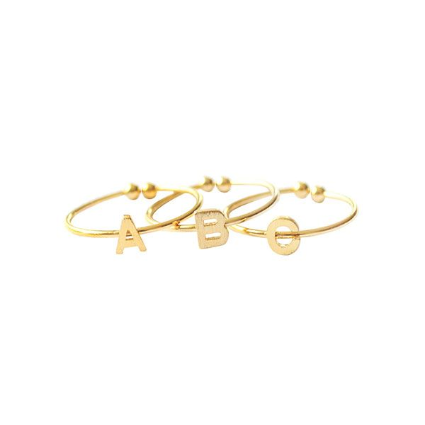 Wanderlust & Co.,Christian Louboutin Alphabet Rings