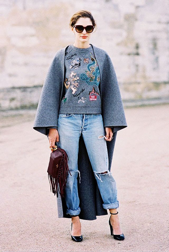 An oversized cape-style coat hits two trends in one. Take your outfit to cool-girl territory with boyfriend jeans, a statement sweatshirt, and fringed accessories.