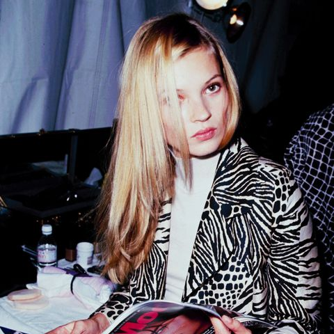 Kate Moss reading magazine backstage c. 1990s