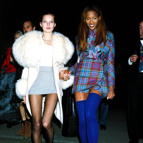 Kate Moss with Naomi Campbell at the London Fashion Week Designer of the Year Awards in 1991