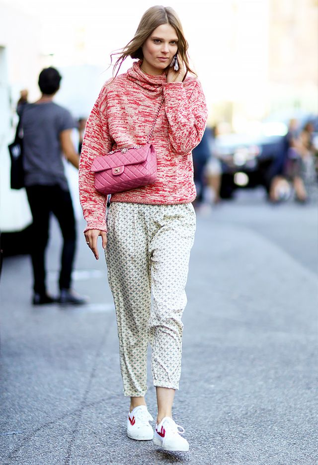 Style Tip: Go for undone appeal, and wear your sweater with a pair of silky pants and sneakers.