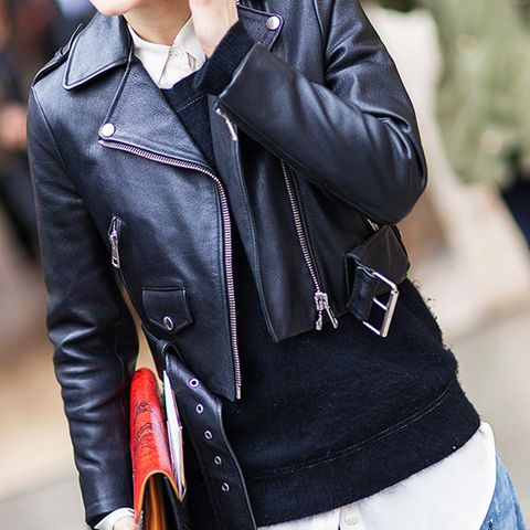 cropped moto jacket over sweater