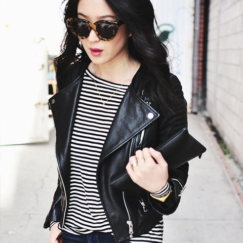 moto jacket over striped shirt