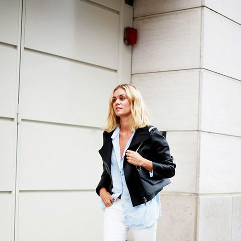 leather jacket over white jeans