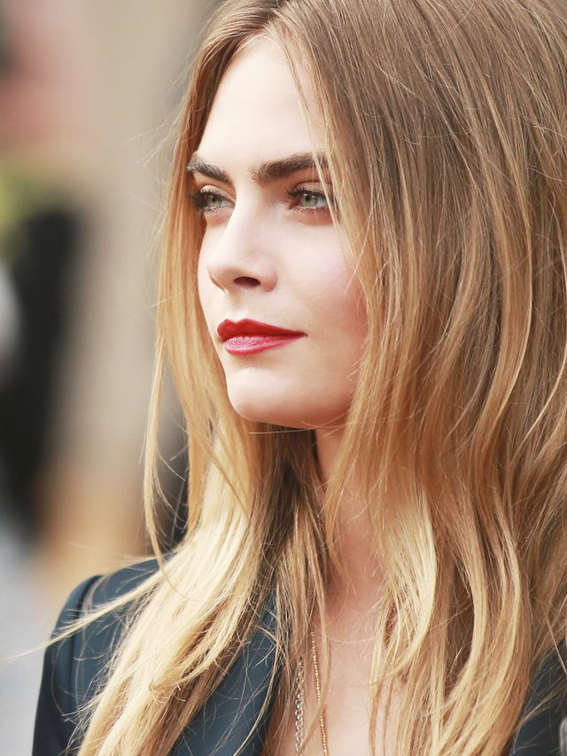 Watch Cara Delevingne Roll Around on a Beach for John Hardy