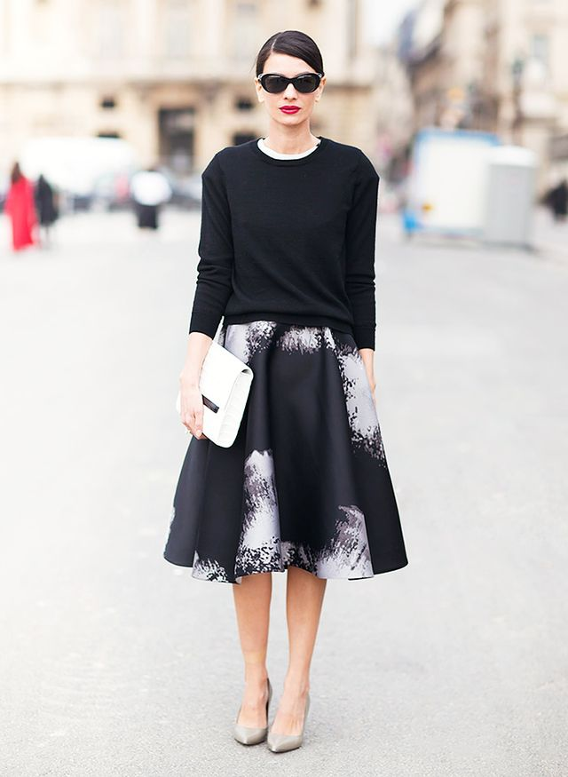 1.  Black Crew-Neck Sweater + A-Line Skirt + Pointed Pumps