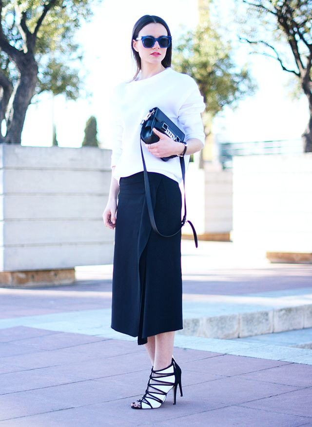 5. White Sweater + Black Midi Skirt + Edgy Accessories
