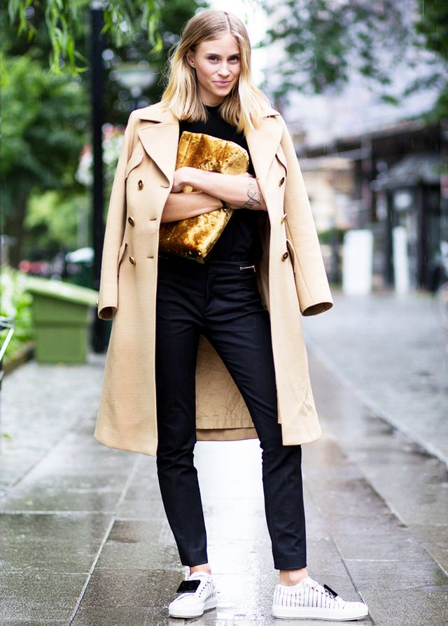 Lend sophistication to your sneakers with streamlined black separates and a beautiful camel coat:
