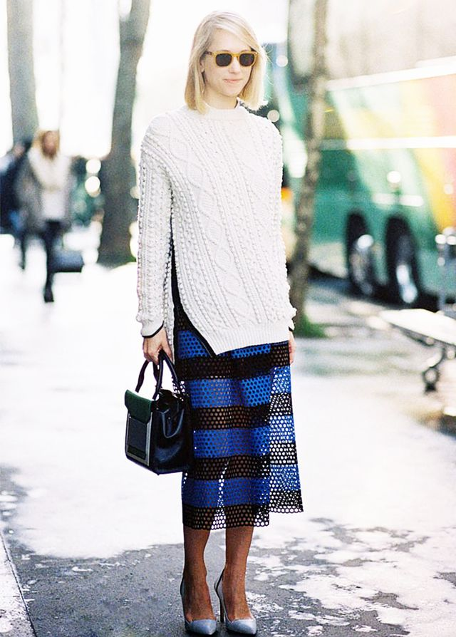 Team a slouchy sweater with a midi skirt and heels for a touch of elegance: