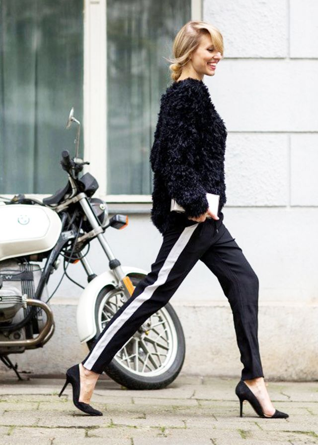 Track pants look evening-ready when worn with a statement sweater and pointy-toe pumps: