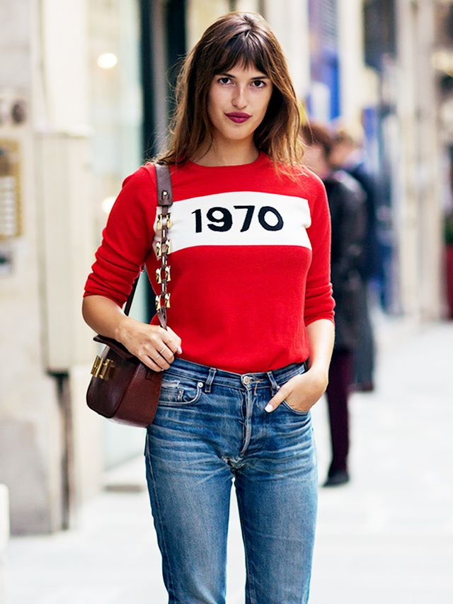 tip of the day jeanne damas shows us how to wear a sweater whowhatwear uk. Black Bedroom Furniture Sets. Home Design Ideas