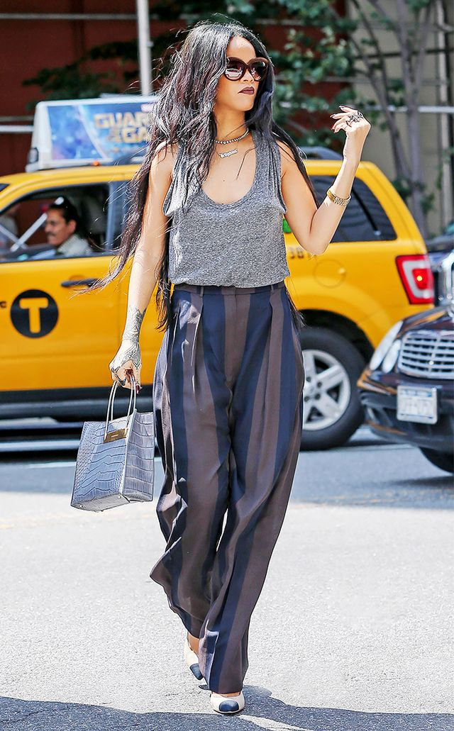 On Rihanna: T by Alexander Wang tank; Haider Ackermann trousers; Balenciaga bag; Chanel pumps; Italia Independent 0092V Sunglasses ($197).