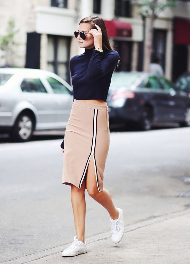 Dress a camel pencil skirt down with sneakers and a crop top: