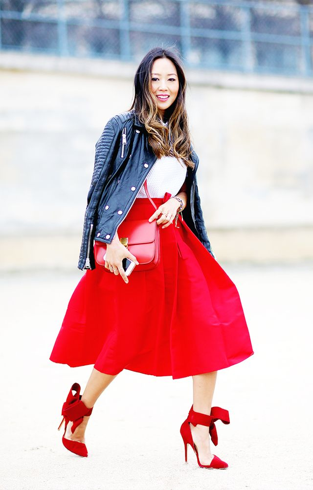 Style Tip: Opt for a bold colour scheme, and match your accessories to a bright red midi skirt.