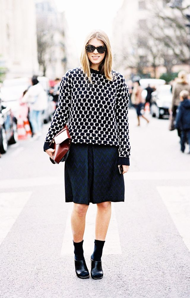 Style Tip: Give your knee-length pleated skirt a preppy twist, and wear it with a knit pullover, slouchy socks and mules.
