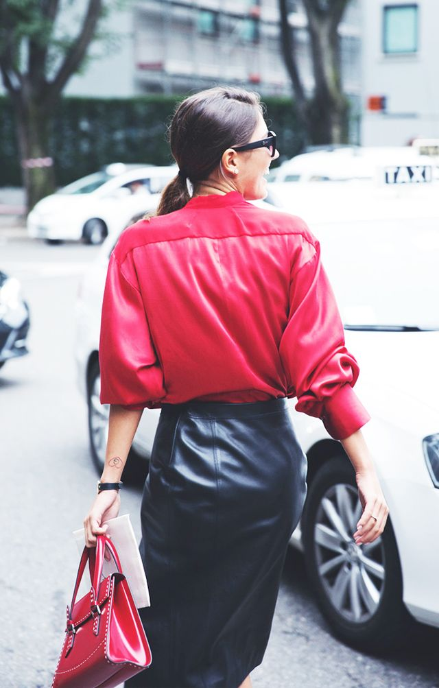 Style Tip: A button-down shirt and leather skirt—works every time.