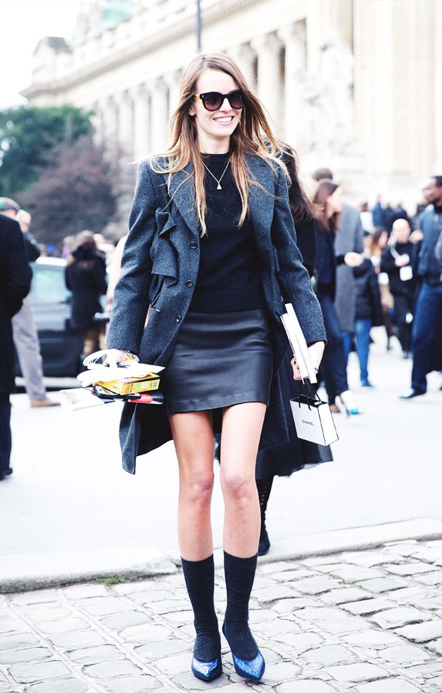 Style Tip: Play up different proportions and try a long coat with a leather miniskirt, socks, and pointy-toe flats.