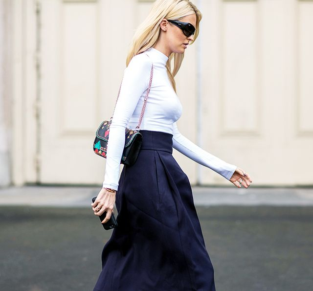 Style Tip: Give your satin skirt a boost with a sleek white shirt and chain-strap bag.