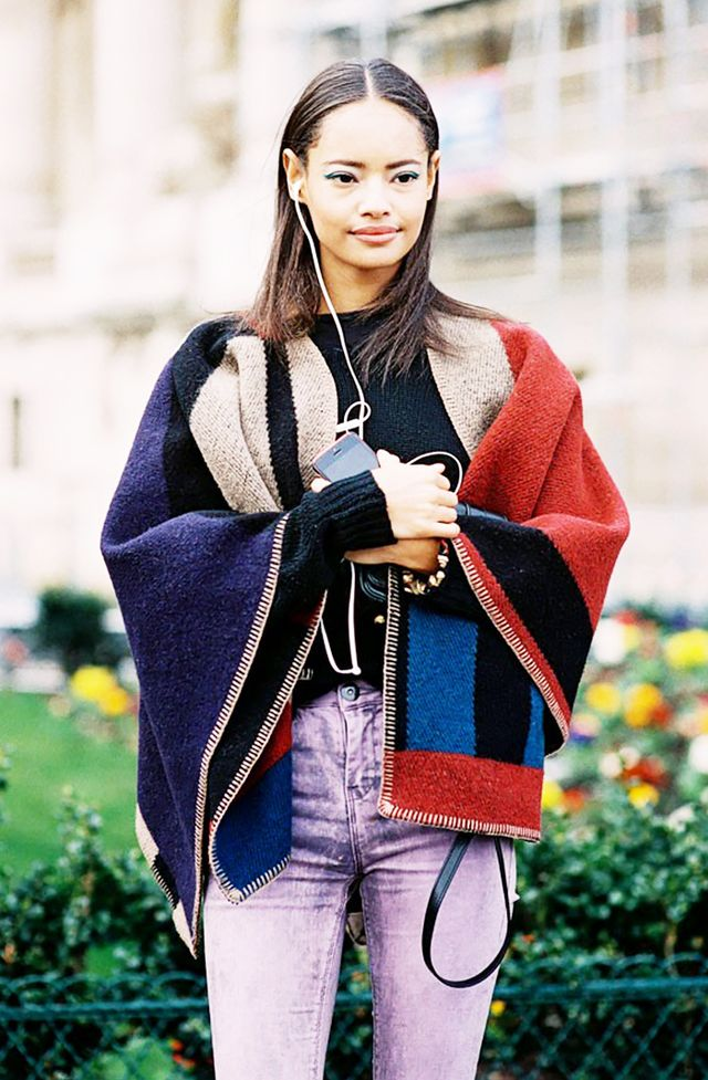 Styling tip: The proportions of a cape-style blanket pairs well with skinny jeans: