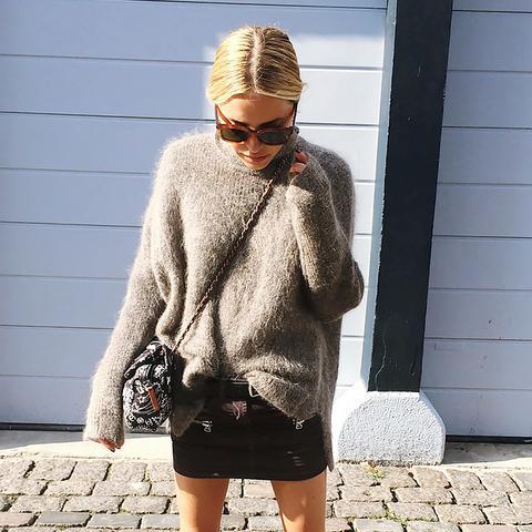 black mini skirt with turtleneck sweater