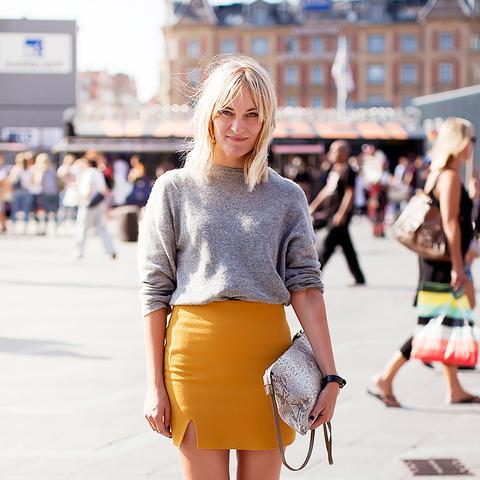 yellow mini skirt with grey sweater
