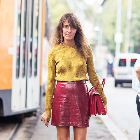 red leather mini skirt and yellow sweater