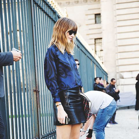 leather mini skirt with blue blouse