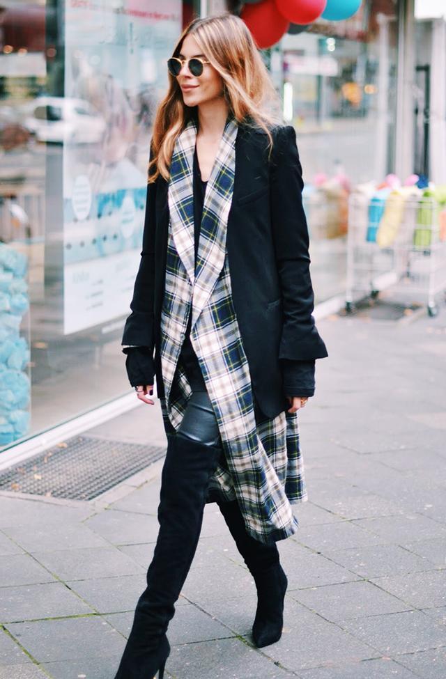 On Maja Wyh: Zara blazer and boots; vintage coat; Ray-Ban Round Folding Classic Sunglasses ($250).