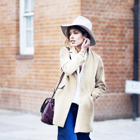 blue pants and beige coat