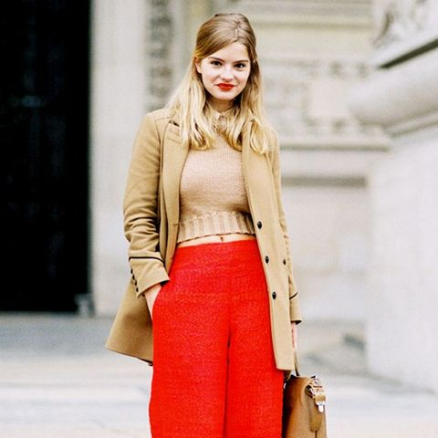 red knit trousers and camel coat