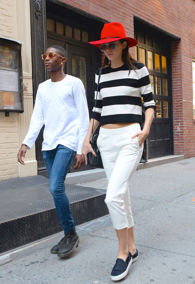 Kendall Jenner in Theory top and pants, Janessa Leone hat, and Celine bag