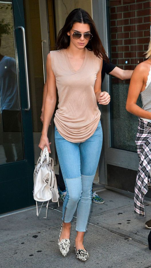 Kendall Jenner in Paige jeans, Ray Ban sunglasses, 3.1 Phillip Lim shoes, Balenciaga bag