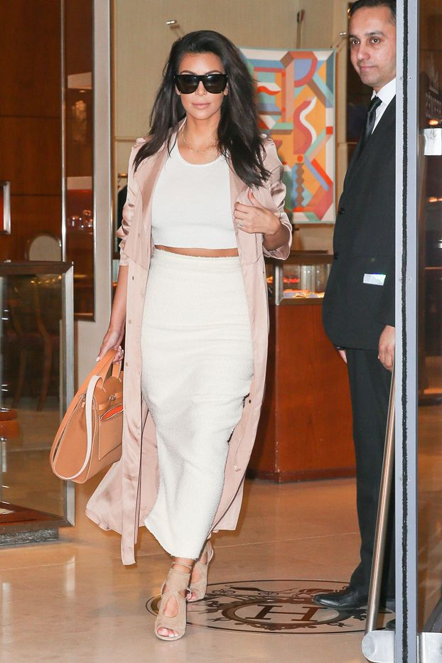 Kim Kardashian in Lanvin coat, Aquazzura shoes, Hermès bag