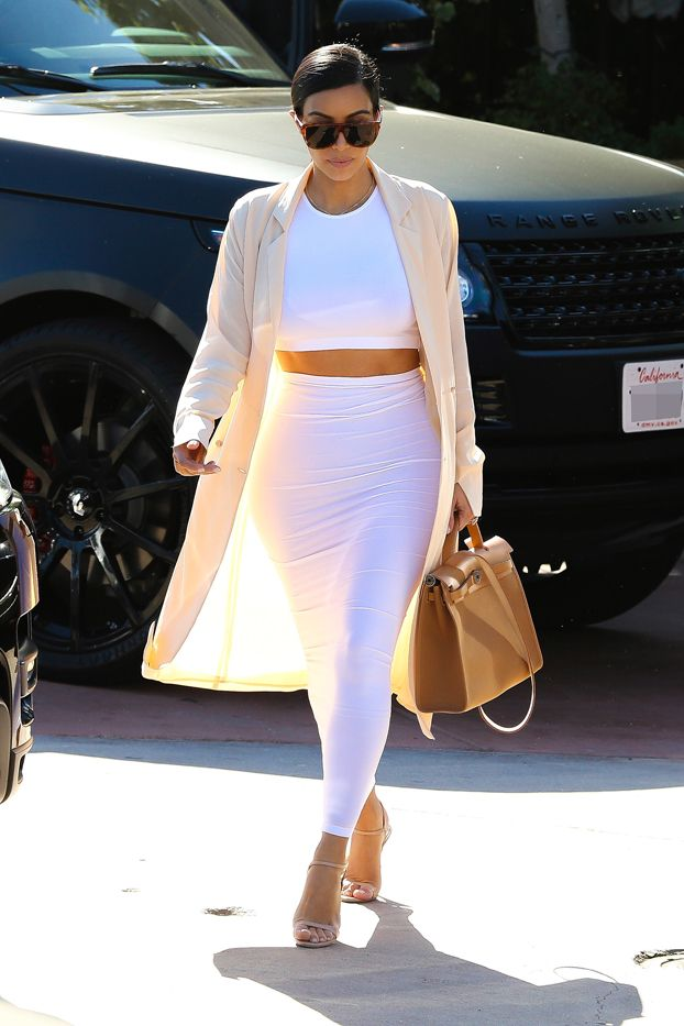 Kim Kardashian in Maison Martin Margiela coat, Wolford dress, Hermès bag, Prada shoes