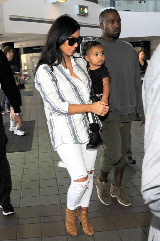Kim Kardashian in J Brand jeans, Hermès shoes