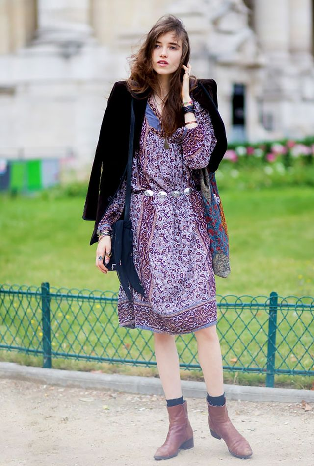 Here's how you do boho chic: A bohemian midi dress and velvet jacket are enough on their own, but letting your socks peek out above your boots really takes it to the next level.