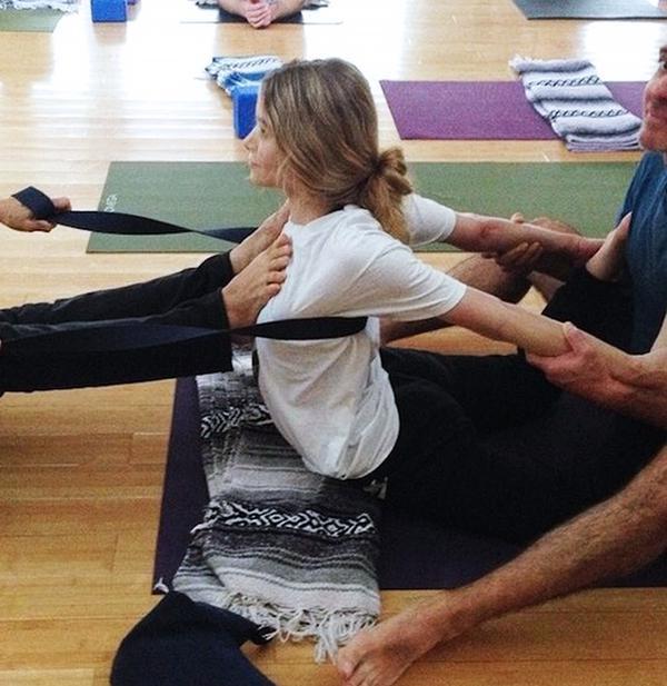 Ashley Olsen practicing yoga at Kyle Miller Yoga Studio.