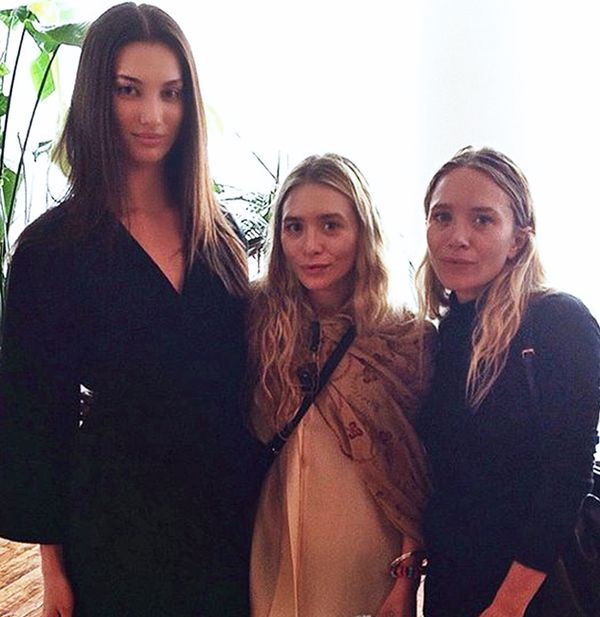 Mary Kate and Ashley Olsen with model Dana Taylor at the Row S/S 15 show at New York Fashion Week.