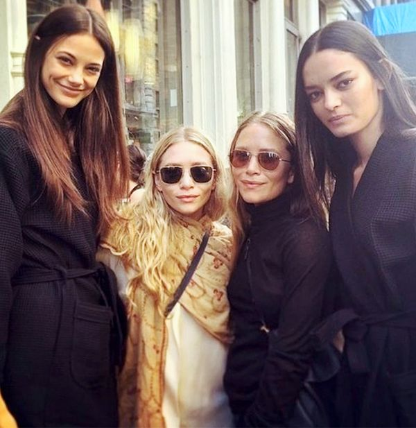 Mary-Kate and Ashley Olsen with models at The Row S/S 15 presentation during New York Fashion Week.