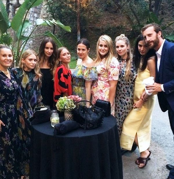 Mary-Kate and Ashley Olsen at a friend's wedding. Mary-Kate is wearing Celine.